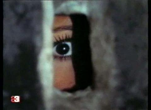 Ana Belen eavesdrops on a disturbing conversation about her and her husband in Morbo (1972).