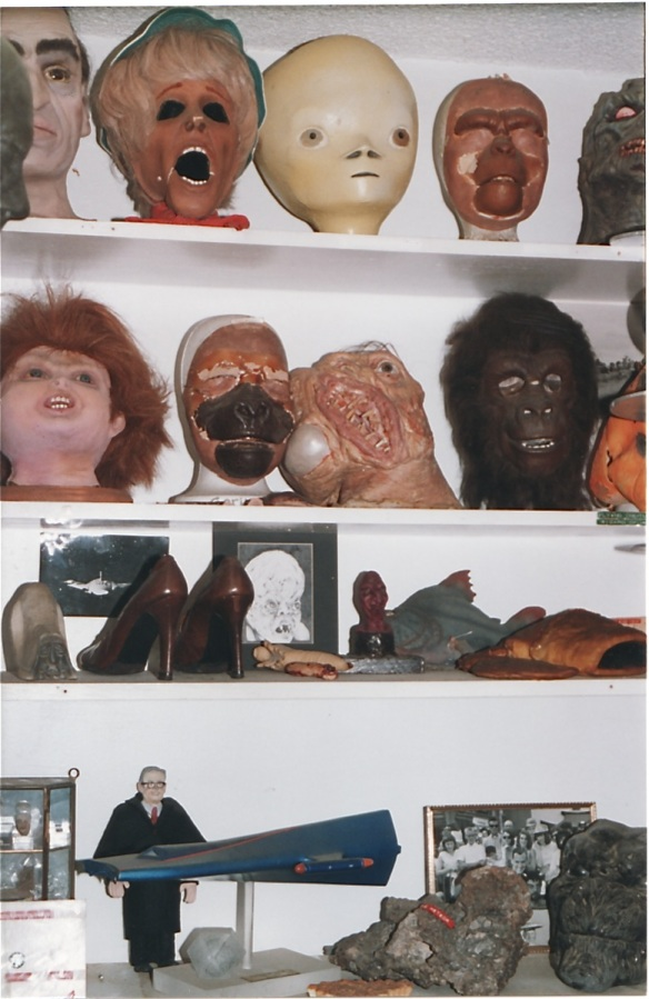 One of many shelves filled with collectibles at The Ackermansion (1998) photo by J. Stafford