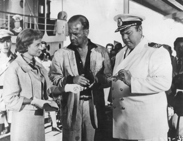 Sylvia Syms, Curd Jurgens and Orson Welles (right) in Ferry to Hong Kong