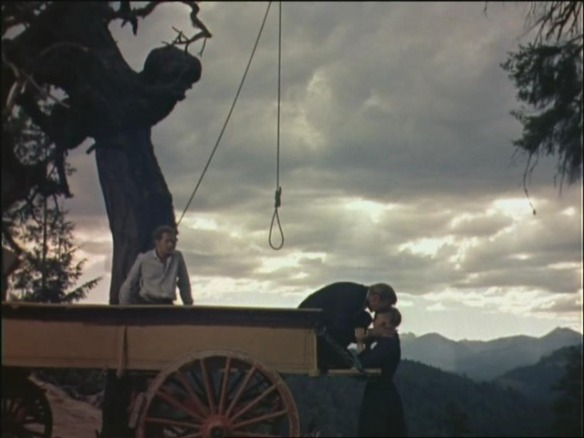 Ben Piazza (left), Gary Cooper and Maria Schell on right in The Hanging Tree (1959)