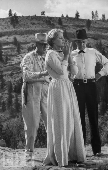 Director Delmer Daves (left), Maria Schell and Gary Cooper on the set of The Hanging Tree (1959)