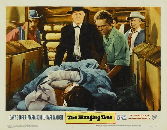Gary Cooper (center), Ben Piazza (right of Cooper) in The Hanging Tree (1959)