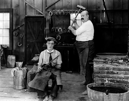 Buster Keaton and Joe Roberts in the 1922 two-reeler comedy, The Blacksmith