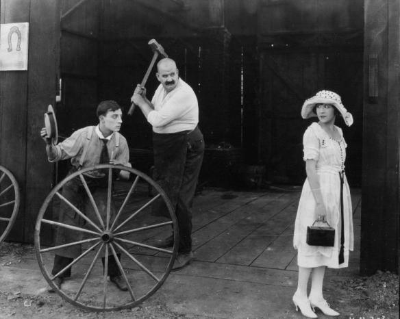 Buster Keaton, his irate boss Joe Roberts and his future fiancee Virginia Fox in The Blacksmith (1922)