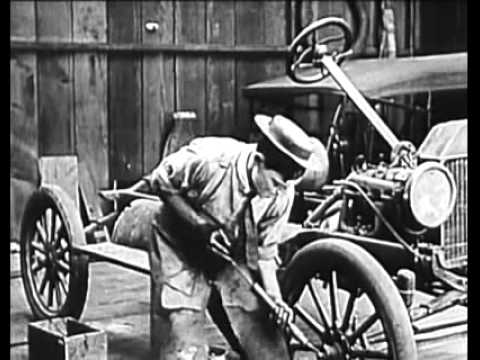 Buster Keaton attempts to rebuild a model-T wreck and destroys a Rolls-Royce in the process in The Blacksmith (1922).