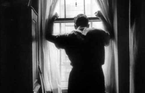 Prizefighter Walter Cartier gazes out his window in the 1951 short, Day of the Fight (directed by Stanley Kubrick)