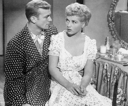 Aldo Ray and Judy Holliday in George Cukor's The Marrying Kind (1952)