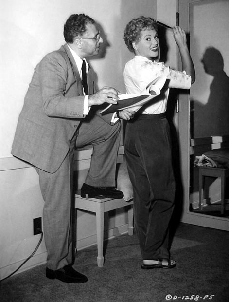 A publicity still of director George Cukor on the set of The Marrying Kind with Judy Holliday