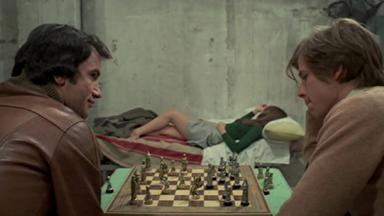 Simon Andreu (left), Inma de Santis (background) and John Moulder-Brown in Forbidden Love Game (1975)