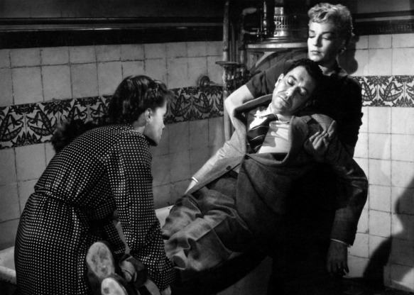 Vera Clouzot (left) and Simone Signoret prepare Paul Meurisse for a trip to the bottom of a swimming pool in Henri-Georges Clouzot's Diabolique (1955)