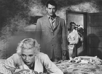 Richard Egan berates Beverly Michaels in a scene from Wicked Woman.