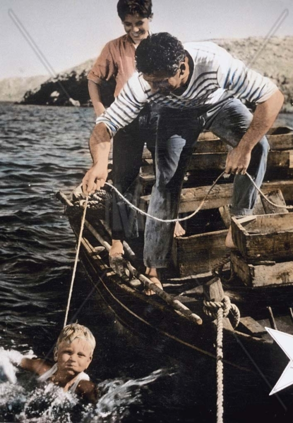 A fisherman (Yves Montand) and his two sons in the late period neorealism drama, The Wide Blue Road (1957)