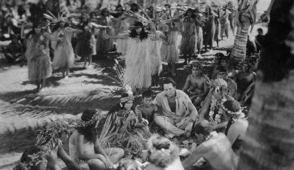 Monte Blue (center, beside native boy) in the wedding ceremony scene from White Shadows in the South Seas (1928)