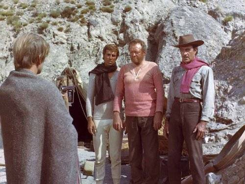 Klaus Kinski (far left) aims his gun at his fellow gold hunters in The Ruthless Four (1968)