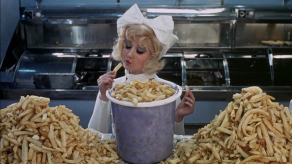 Adrienne Posta has a fondness for chips in Here We Go Round the Mulberry Bush (1967)