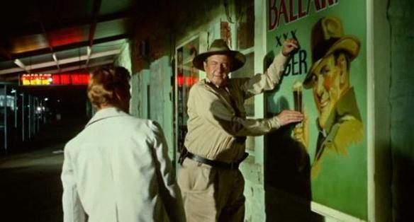 Local native Chips Rafferty (left) has some advice for visitor Gary Bond in Wake in Fright aka Outback (1971)