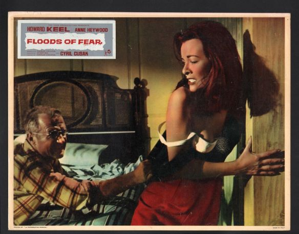 Escaped prisoner Cyril Cusack attacks Anne Heywood in the disaster drama, Floods of Fear (1958)
