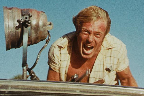 Jack Thompson is exhilarated by the thrill of the hunt in Wake in Fright (1971)