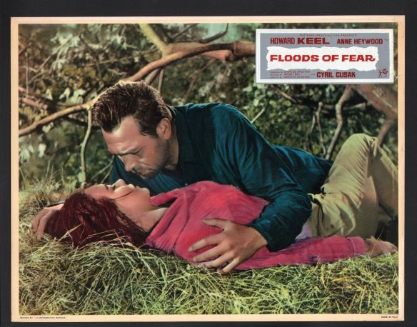 A brief romantic interlude for Howard Keel and Anne Heywood in the disaster drama, Floods of Fear (1958)