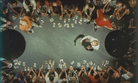 "An overhead view of the coin toss gambling game ""Two-Up"" in Ted Kotcheff's Wake in Fright (1971)"
