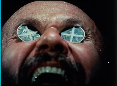 Donald Pleasence in an iconic scene from Wake in Fright (1971)