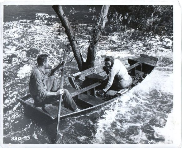 Howard Keel and Anne Heywood try to navigate to safety in Floods of Fear (1958)