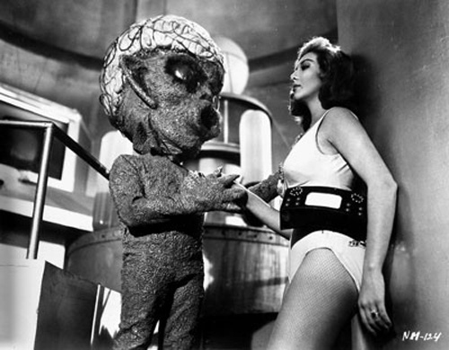 A Venusian woman (Lorena Velazquez, right) contemplates the breeding potential of an alien suitor in La Nave de los Monstruos (1960)