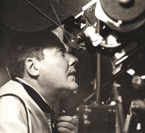 A young Robert Altman ponders a camera set-up.