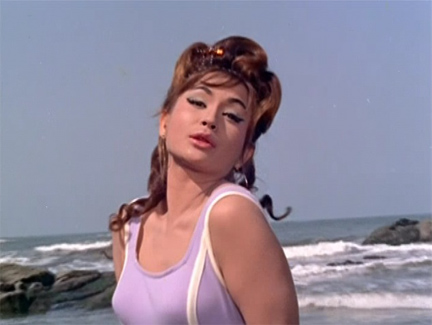 Helen does an exotic beach sequence musical number in Gumnann (1965)