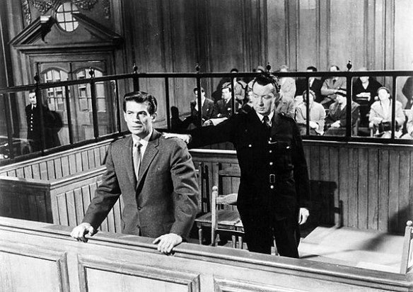 George Nader as con artist Paul Gregory receives an unexpectedly harsh sentence in this scene from Nowhere to Go (1958)