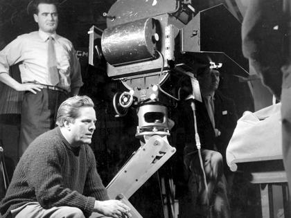 Director Seth Holt (sitting, left) on the set of Nowhere to Go (1958)