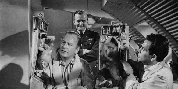 Curd Jurgens (far left) experiments with monkeys for his space exploration program in I Aim at the Stars (1960)