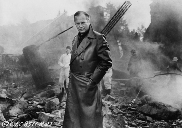 Curd Jurgens as scientist Wernher von Braun witnesses the effects of his V-2 missiles in I Aim at the Stars (1960)