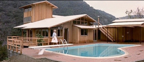 Kim Novak outside the dream house being designed by architect Kirk Douglas in Strangers When We Meet (1960).