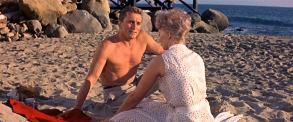 Kirk Douglas & Kim Novak cheat on their spouses in the 1960 soap opera, Strangers When We Meet.