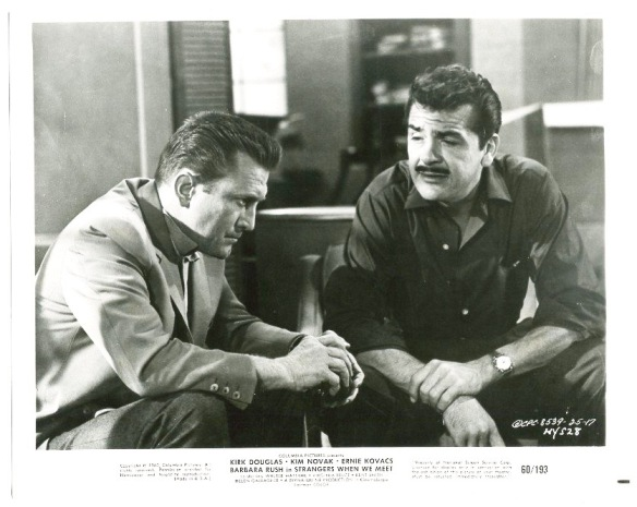 Architect Kirk Douglas shares his personal troubles with successful author Ernie Kovacs in Strangers When We Meet (1960).