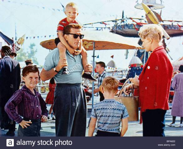 Married architect Kirk Douglas with his kids meets housewife Kim Novak and her child in Strangers When We Meet (1960).