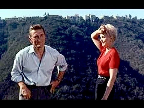 Kirk Douglas & Kim Novak star in Strangers When We Meet (1960), directed by Richard Quine