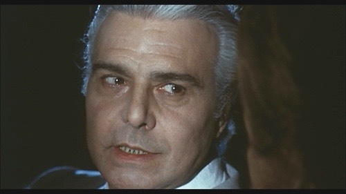 Gianni Santuccio plays the ominous stranger David (Ray Lovelock) meets on the road at night in Queens of Evil (1970).