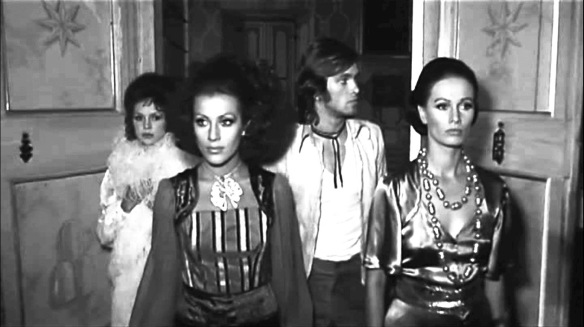 The three sisters and their house guest (Ray Lovelock) attend a strange party at a nearby castle in Queens of Evil (1970), directed by Tonino Cervi.