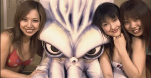Female fans pose with Japan's latest sports hero in The Calamari Wrestler (2004).