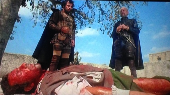 Count Francesco Cenci (George Wilson, on right) looks down on the unfortunate victim of the count's trained dogs in Lucio Fulci's Beatrice Cenci.
