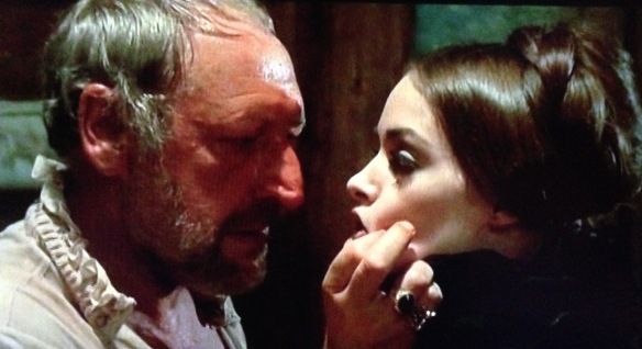 The perverse Count Cenci (George Wilson) threatens his daughter Beatrice (Adrienne Larussa) with physical abuse in the Lucio Fulci historical drama.