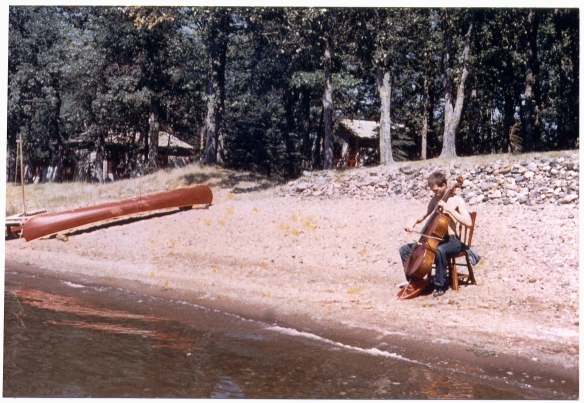 Arthur Russell playing his cello by the lake in Iowa.