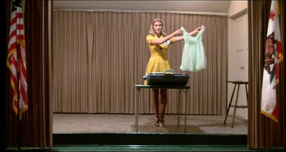 Colleen Camp as Connie demonstrates the art of packing a suitcase in Smile (1975), directed by Michael Ritchie
