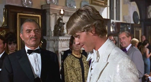 James Mason (left) and James Fox (center) star in the 1968 pop art heist happening, Duffy.