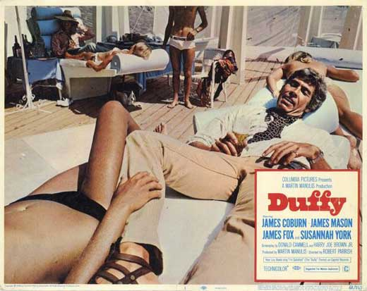 James Coburn amid the sun worshippers in sunny Spain in Duffy (1968).