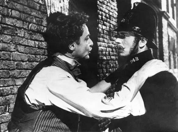 Robert Donat (left) and Laurence Olivier in a cameo as a London bobby in The Magic Box (1951).