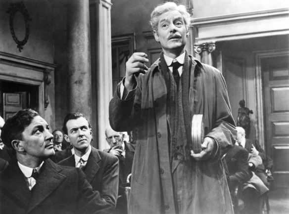 Robert Donat as cinema pioneer William Friese-Greene in his final days in the biopix The Magic Box (1951).
