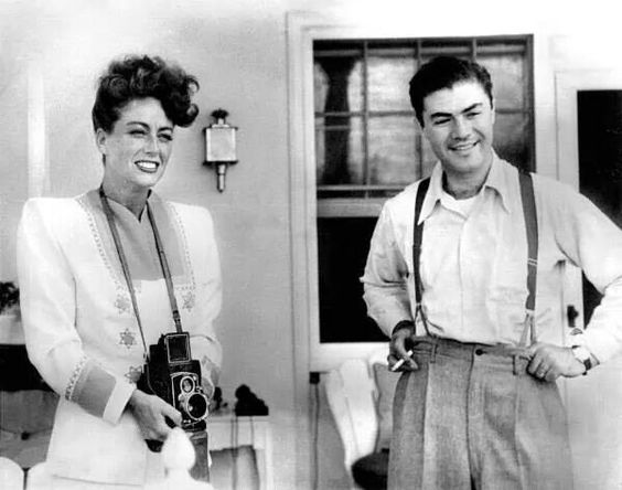 Joan Crawford poses with a camera with famous photographer Phil Stern